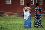 Two mothers visiting the Kiballe health centre, Uganda